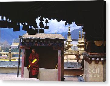 Tibetan Buddhism Canvas Print - Tibetan Monk With Scroll On Jokhang Roof by Anna Lisa Yoder