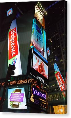 Times Square Ads Canvas Print by Jim Hughes