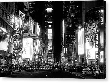 Times Square At Night Canvas Print by John Rizzuto