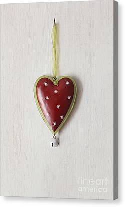 Canvas Print featuring the photograph Tin Heart Hanging On Wood by Sandra Cunningham