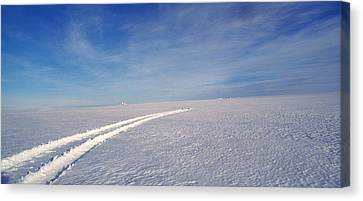 Tire Tracks On A Snow Covered Canvas Print by Panoramic Images