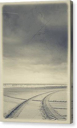 Tire Tracks On The Beach Canvas Print by Marco Oliveira