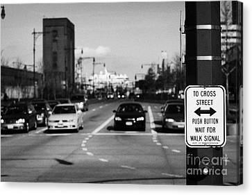 to cross street push button wait for walk signal sign 12th Avenu new york city Canvas Print by Joe Fox