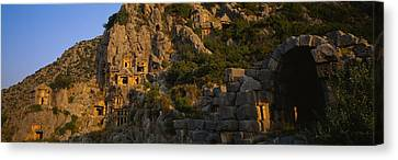 Tombs On A Cliff, Lycian Rock Tomb Canvas Print by Panoramic Images