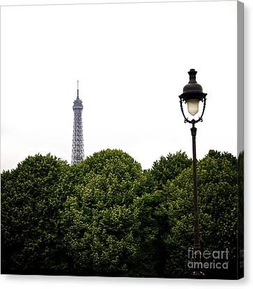 Top Of The Eiffel Tower And Street Lamp. Paris.france. Canvas Print by Bernard Jaubert