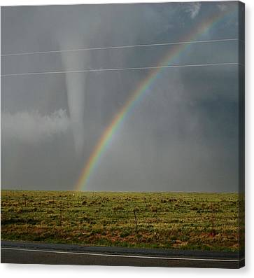 Tornado And The Rainbow Canvas Print by Ed Sweeney