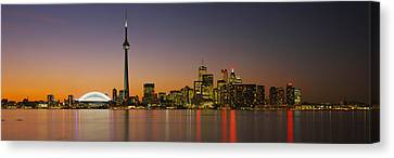 Toronto Skyline At Dusk, Ontario Canada Canvas Print by Panoramic Images
