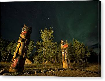 Totem Poles At Night. Tlingit Culture Canvas Print by Peter Mather