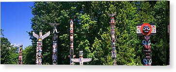 Stanley Park Canvas Print - Totem Poles In A A Park, Stanley Park by Panoramic Images