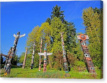 Totem Poles In Stanley Park Canvas Print by Charline Xia