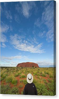 Tourist And Clouds At  Ayers Rock Canvas Print by Yva Momatiuk John Eastcott