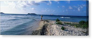 Tourist Fishing On The Beach, Sandy Canvas Print by Panoramic Images