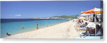 Tourist On The Beach, Porto Carras Canvas Print by Panoramic Images