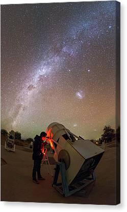 Tourist Using A Telescope Canvas Print by Babak Tafreshi
