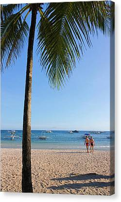 Tourists And Palm Tree On The Beach Canvas Print by Keren Su
