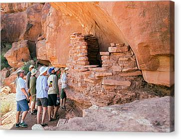 Tourists At An Anasazi Grain Store Canvas Print by Jim West