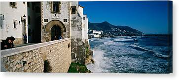 Tourists In A Church Beside The Sea Canvas Print by Panoramic Images