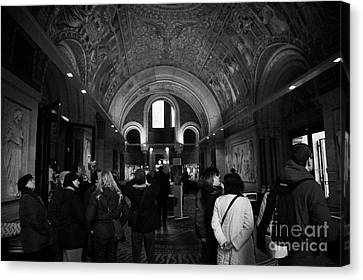 tourists inside the Gedenkhalle memorial hall of Kaiser Wilhelm Gednachtniskirche Canvas Print by Joe Fox