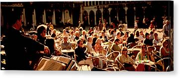 Tourists Listening To A Violinist At A Canvas Print by Panoramic Images