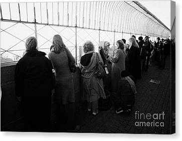 Tourists  Look At The View From Observation Deck Empire State Building Canvas Print by Joe Fox