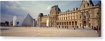 Tourists Near A Pyramid, Louvre Canvas Print by Panoramic Images