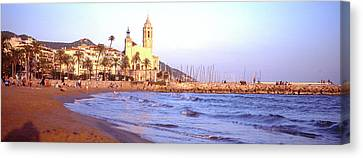 Tourists On Beach, Sitges, Barcelona Canvas Print by Panoramic Images