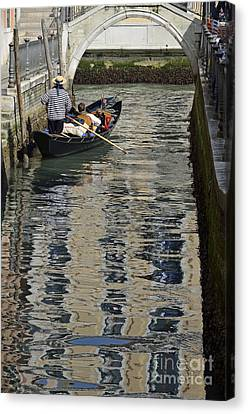 Tourists On Gondola On Canal Canvas Print by Sami Sarkis