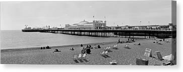 Tourists On The Beach, Brighton, England Canvas Print