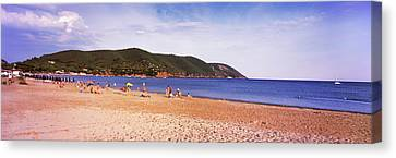 Tourists On The Beach, Island Of Elba Canvas Print by Panoramic Images