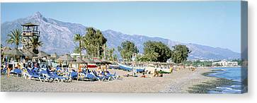Pedro Canvas Print - Tourists On The Beach, San Pedro, Costa by Panoramic Images