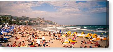 Tourists On The Beach, Sitges, Spain Canvas Print by Panoramic Images