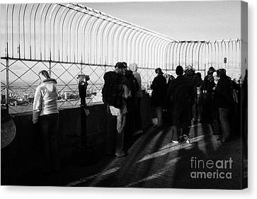 Tourists On The View From Observation Deck  Empire State Building New York City Usa Canvas Print by Joe Fox