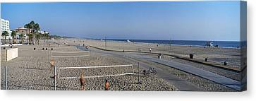 Tourists Playing Volleyball Canvas Print by Panoramic Images