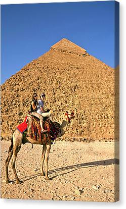 Tourists Ride A Camel In Front Canvas Print by Miva Stock