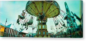 Tourists Riding On An Amusement Park Canvas Print by Panoramic Images