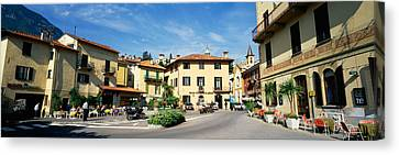 Tourists Sitting At An Outdoor Cafe Canvas Print by Panoramic Images