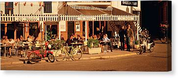 Tourists Sitting In A Cafe, Sitges Canvas Print by Panoramic Images