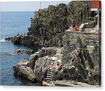 Tourists Sunbathing On The Rocks Canvas Print