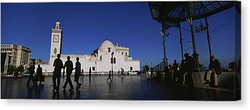 Tourists Walking In Front Of A Mosque Canvas Print