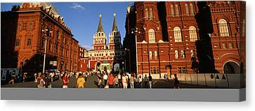 Tourists Walking In Front Of A Museum Canvas Print