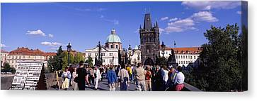 Tourists Walking In Front Canvas Print