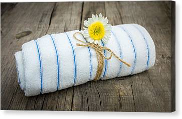 Towel With A Flower Canvas Print