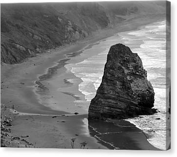 Towering Rock Canvas Print by Kirt Tisdale