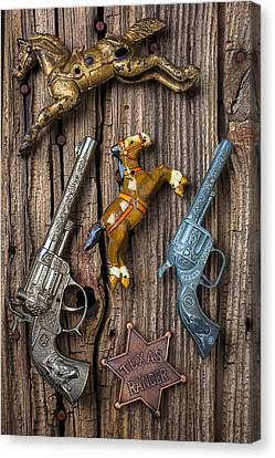 Toy Guns And Horses Canvas Print by Garry Gay