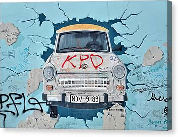 Trabant On The Berlin Wall Canvas Print by Gynt