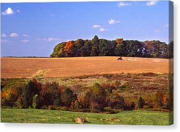 Tractor After The Harvest Canvas Print by Jerry Tompkins