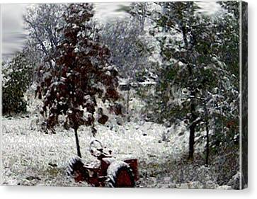 Tractor In The Snow Canvas Print by Dennis Buckman