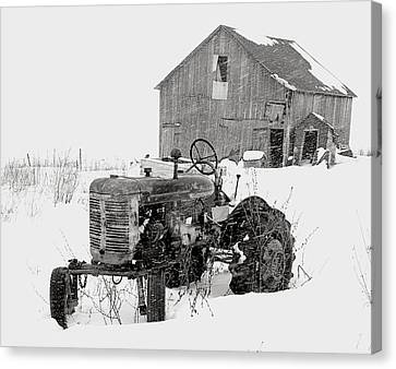 Tractor In Winter Canvas Print by Jim Vance
