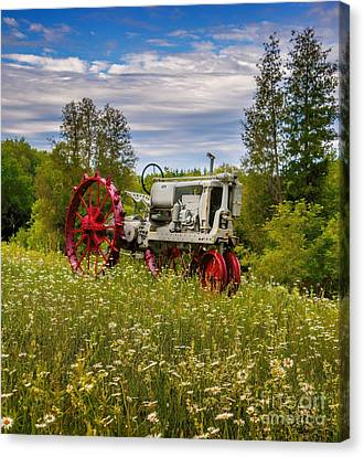 Tractor Out To Pasture Canvas Print by Henry Kowalski