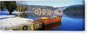 Traditional Boat At The Lake Bled Canvas Print by Panoramic Images